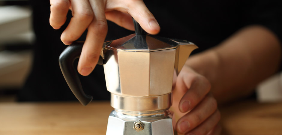 Screwing the top of the moka pot onto the bottom water reservoir stovetop coffee maker how to guide.